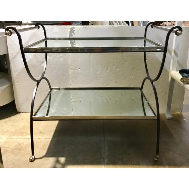 Stylish modern Cyan Design iron and mirror bar cart, two tier, silver and black accents. Showroom floor sample