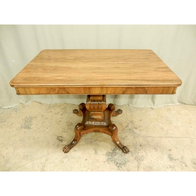 19th-century Italian walnut rectangular table with a beautifully carved pedestal base. Can function properly as a console,...