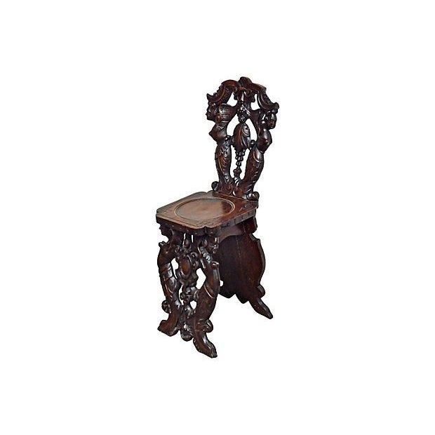 This antique carved Gothic Revival hall chair dates back to the 19th  century, and features - Antique Carved Gothic Revival Hall Chair Chairish