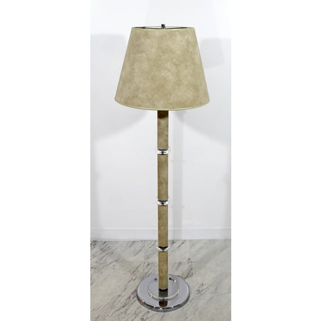 For your consideration is a magnificent floor lamp, with a chrome base, Lucite accents and wrapped in tan suede, circa...