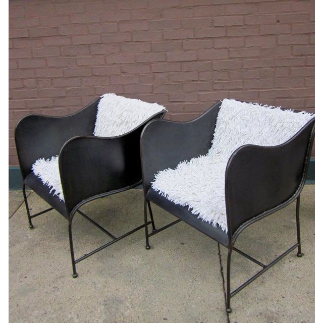 This is a pair of vintage industrial-style brutalist metal chairs, likely custom made and one of a kind as we've never...