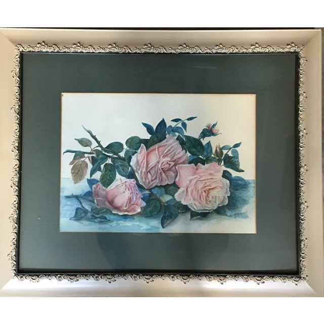 This floral watercolor signed lower right, comes with a gorgeous off white frame and with wood backed panels. Given the...