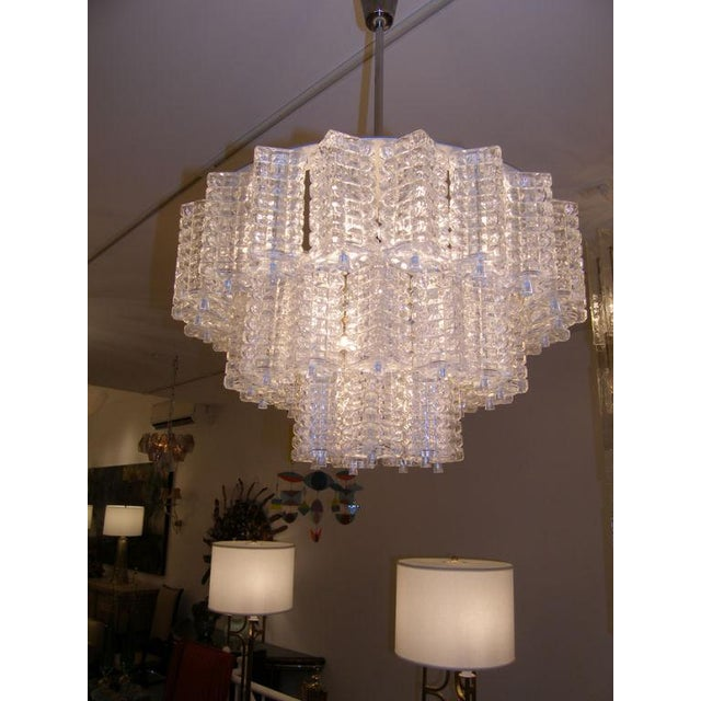 Orrefors 3 Tiered Crystal Chandelier with nickel hardware.