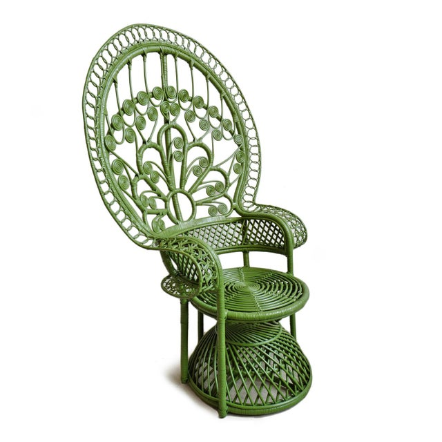 Vintage style classic moss green peacock wicker chair. Beautiful hand crafted natural wicker workmanship with a green...