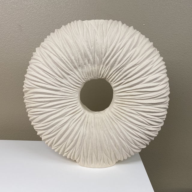 Design Plus Gallery presents a Phillips Collection Waves Circle Vase. Manufactured of stone cast off white resin...