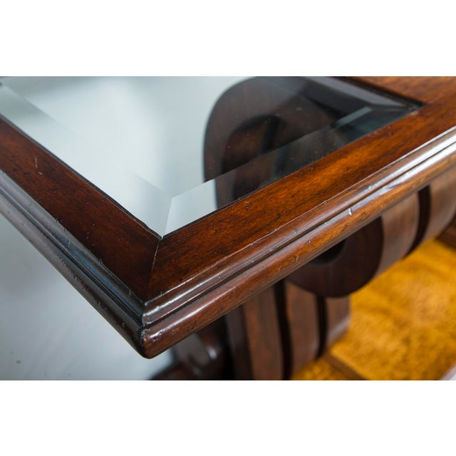Walnut console table w/ glass inserts sitting on large curved wood pedestals. By John Richards