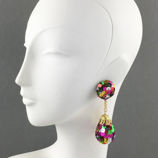 Funky disco pair of clip-on earrings. Dangling chandelier shape with multicolor iridescent sequins. Large disco drop...