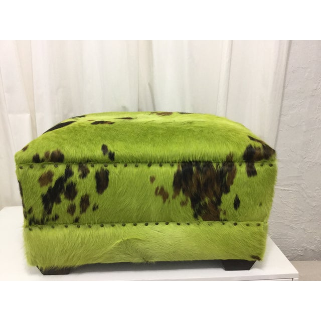 Vintage rectangular ottoman upholstered in natural dye technique lime green cowhide. Gorgeous piece for any room. Seat Is...