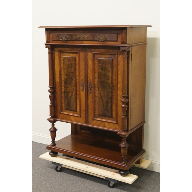 Antique burl walnut and mahogany court cupboard. We specialize in high end used furniture that we consider to be at least...