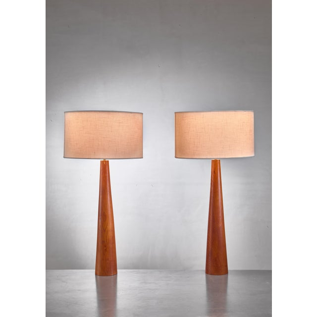 A pair of Swedish wooden table lamps with a conical shape, simple, elegant and earthy. Height base excl. lamp holder: 51...