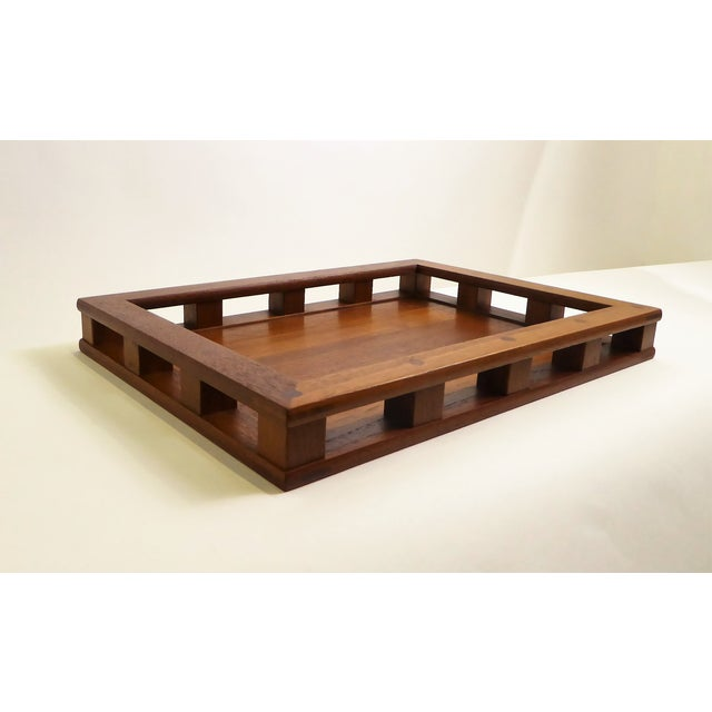 This 1960s Jens Quistgaard designed teak wood serving tray with four thick green glass inserts is from Dansk Designs and...