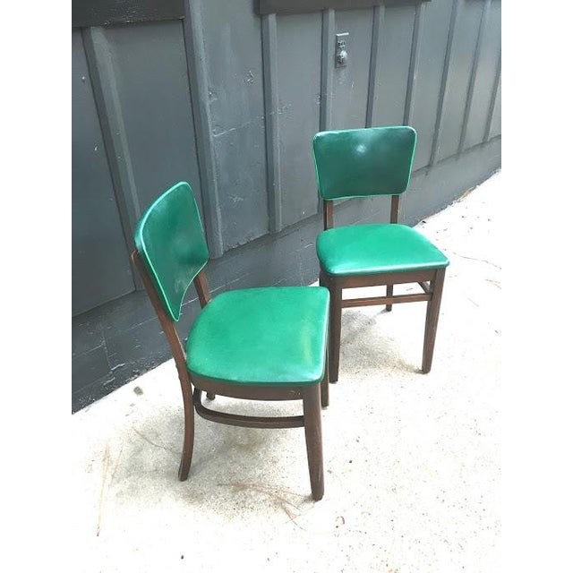 1930s-40s dark green leather w/ lime piping and mahogany wood studded dining chairs by National Furniture Company. Set of...