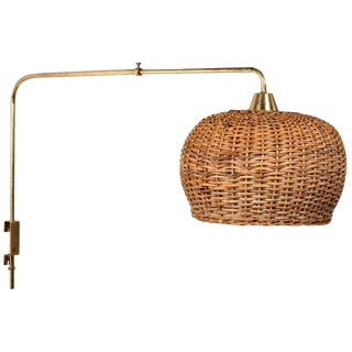 1950s Paavo Tynell Articulating Brass and Wicker Wall Light for Taito Oy For Sale
