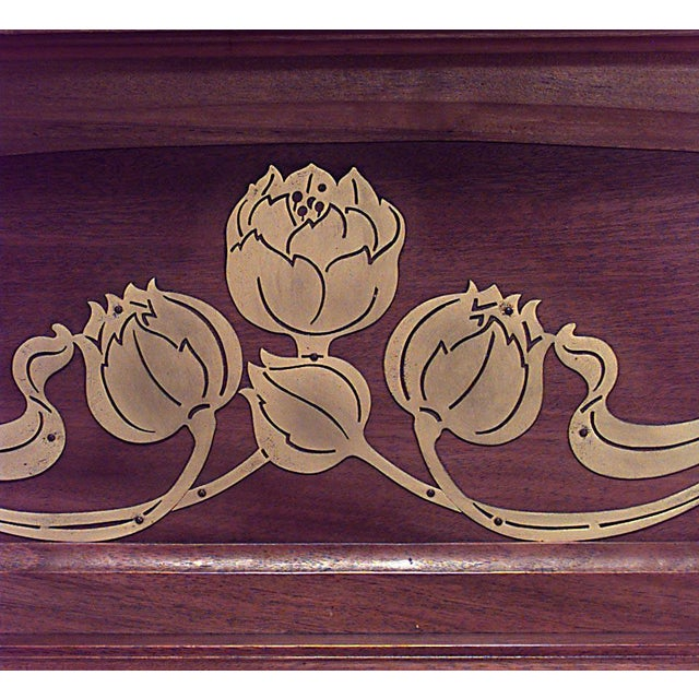 French Art Nouveau walnut fireplace mantel with bronze floral trim and scroll carved sides