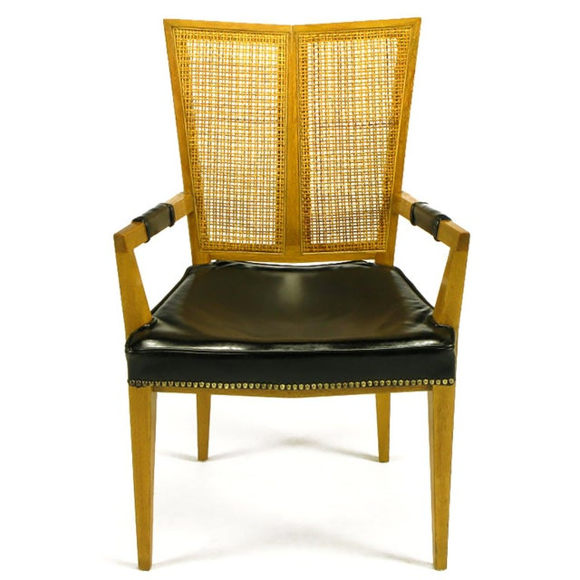 Set of six rare V-back dining chairs. Clean lines, excellent construction and unique form. Includes two arm chairs and...