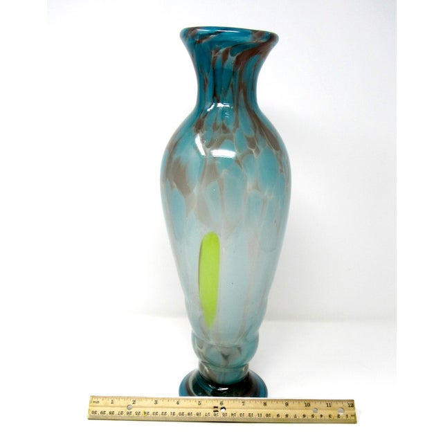 A vintage 1970s hand-blown studio art glass shoulder vase in brown, clear, and pastel blue and green. There is a large...