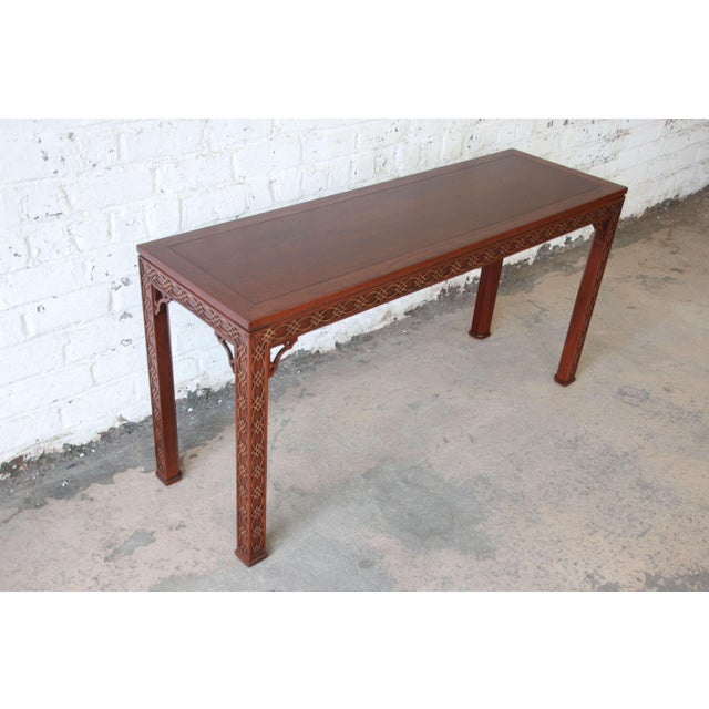 Offering a beautiful newly refinished carved mahogany Chinese Chippendale hall table by Kindel Furniture. This table has...