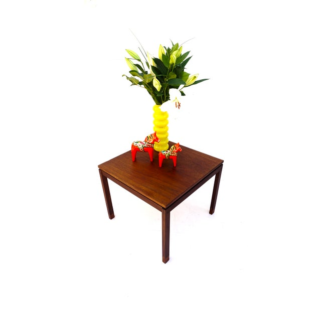Gorgeous vintage Mid-Century Danish teak and rosewood side/accent table by Hans Olsen. This timeless piece features a...
