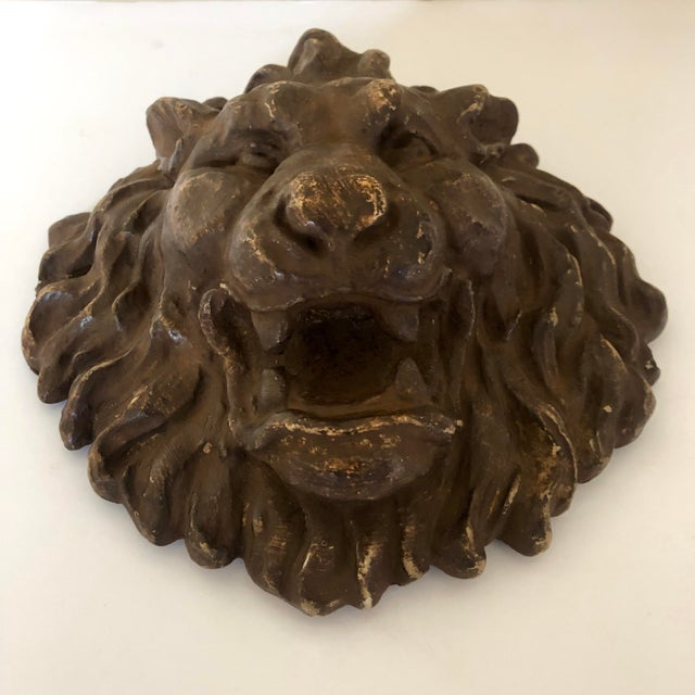 Early 20th c. French plaster lion head plaque.
