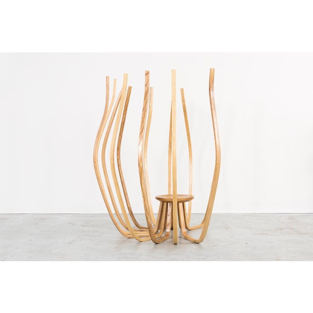 "Clara Kim designed and crafted ""Root"" with an awareness of space. Drawing inspiration from the roots of plants, she built..."