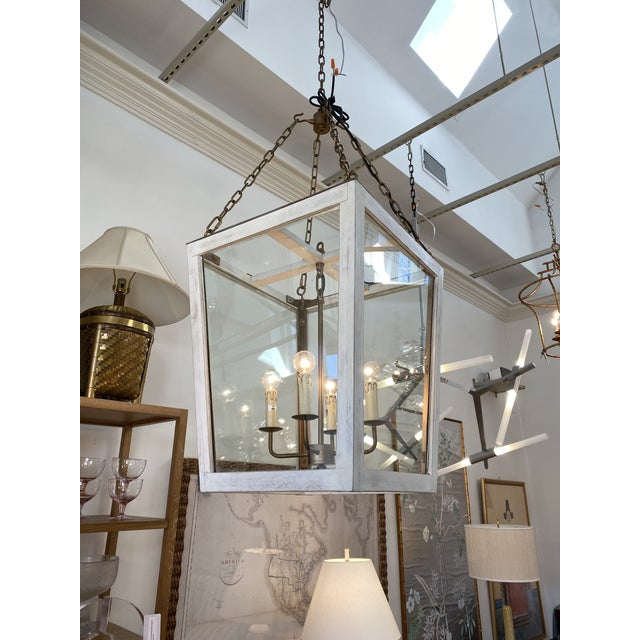 This is a wood and brass lantern by The Julian Chichester Company. This piece would be a perfect fit for a modern...