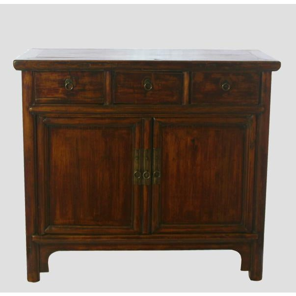 A simple countryside cabinet with its original paint and natural textured wood. It has round smooth posts around doors,...