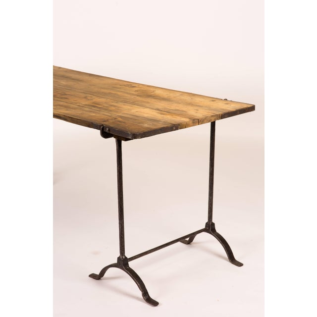Trestle table with iron legs and oakwood top from England circa 1850. Can serve as a desk, or sideboard.