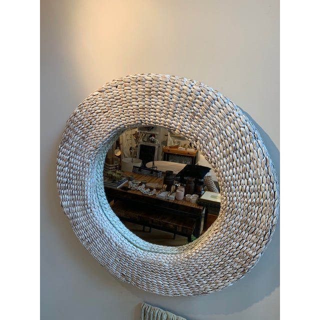 """Round 32"""" rattan white washed wall mirror is a perfect addition to any room."""