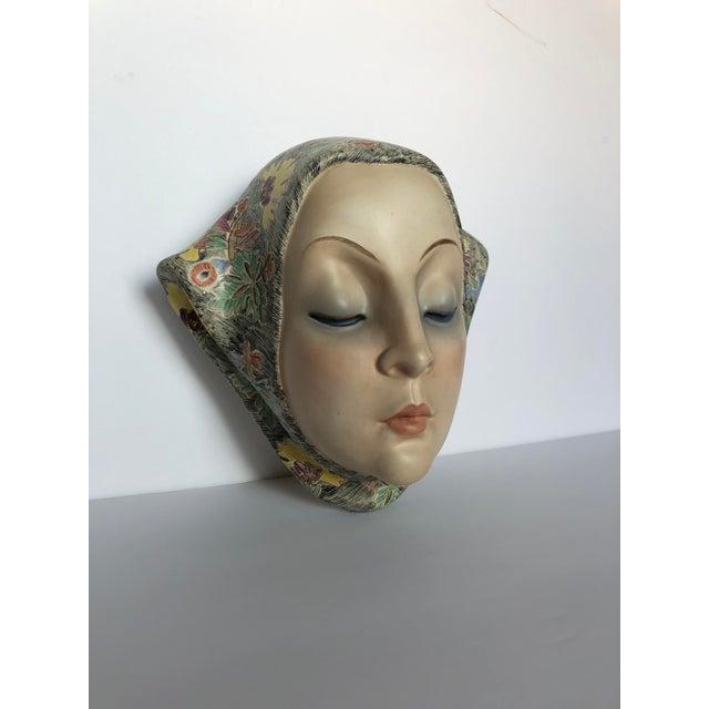 Rare art deco polychrome pottery wall mask by Helen Koenig Scavini for Lenci Torino, Italy.
