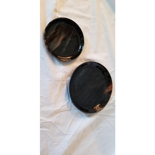 """Lewes round tray set by Pigeon & Poodle Small- 6"""" dia x 1"""" high Large- 8"""" dia x 1"""" high Give simple accessories an exotic..."""