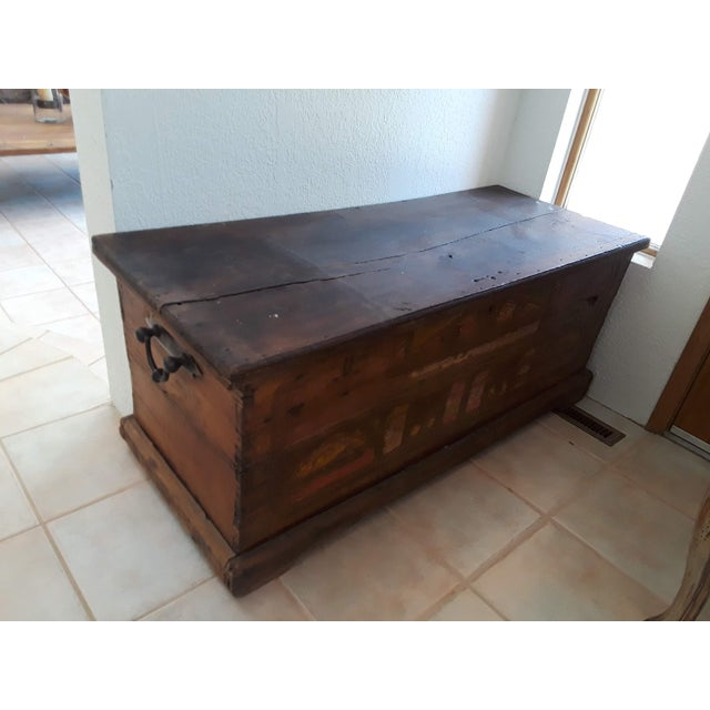 It is a large teak wood storage trunk/ chest with brass hardware from Indonesia with detailing in the front. Very old. Top...