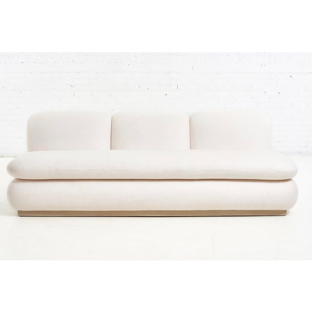 Modern Drama White Boucle Pouf Sofas. Upholstered in Italian wool blend performance boucle. Leather wrapped bases. Priced...