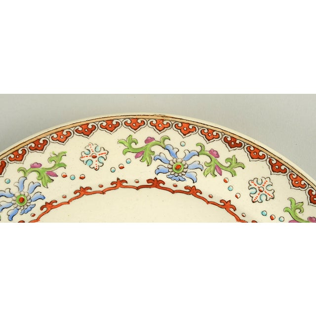 Spode China Canton Dinner Plate Set of 8 features an oriental scene complete with an aqua vase of chrysanthemums, rust...