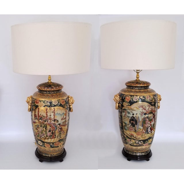Offering a monumental pair of Chinese Export lamps done in the style of Famille Rose, circa 1990s. These very large lamps...
