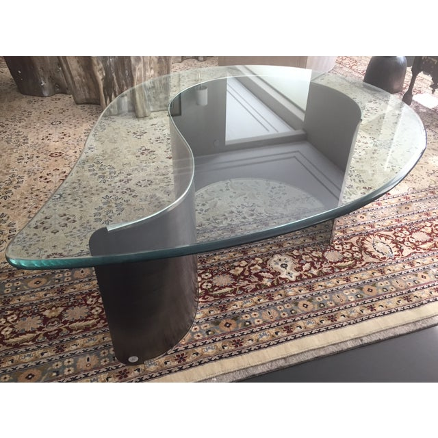 Teardrop coffee table attributed to Karl Springer, USA C. 1980s. Metal and glass.