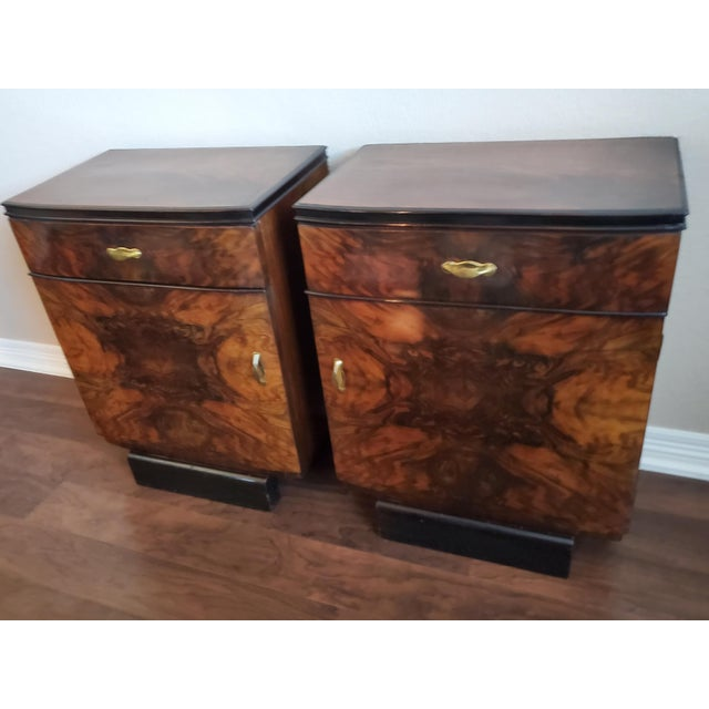 A spectacular pair of original Italian Art Deco period nightstands / bedside cabinets. Handcrafted, highly-figured, book-...