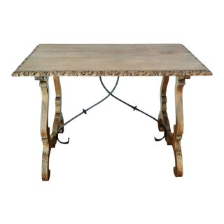 19th Spanish Farm Table with iron stretchers & hand carved top For Sale