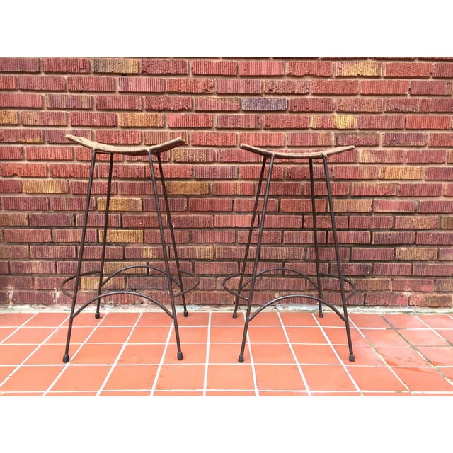 Wouldn't these look amazing at your home bar? This pair of wicker and iron midcentury stools look great anywhere - and...