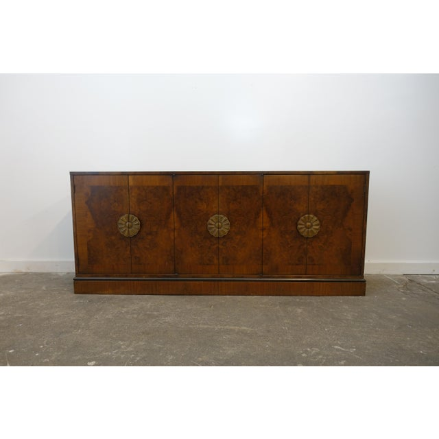 This deco burled wood credenza by Romweber has a great luxurious look. The door handles are very interesting brass flower...