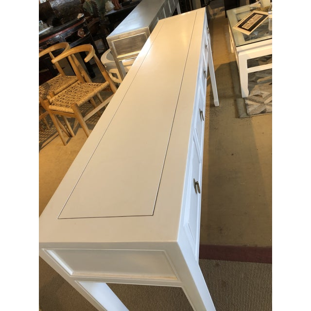 Beautiful high gloss 5 drawer white lacquer console table. Features 5 drawers. Made in the 2010s.