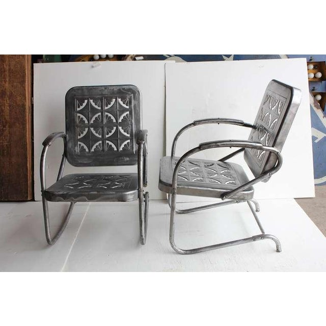Mid Century metal garden rocker chair and arm chair. Newly refinished.