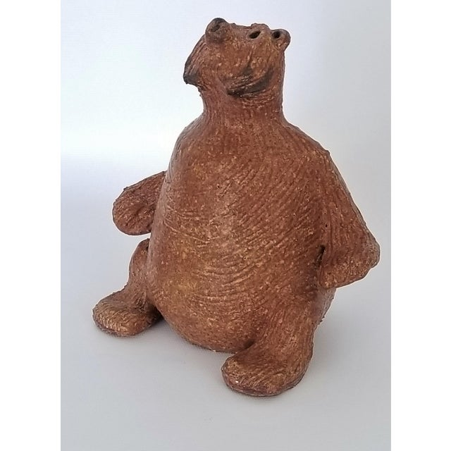 Offering a vintage 1970s Danish Modern Studio Art Pottery brown bear sculpture signed on the bottom: Jarl. This...