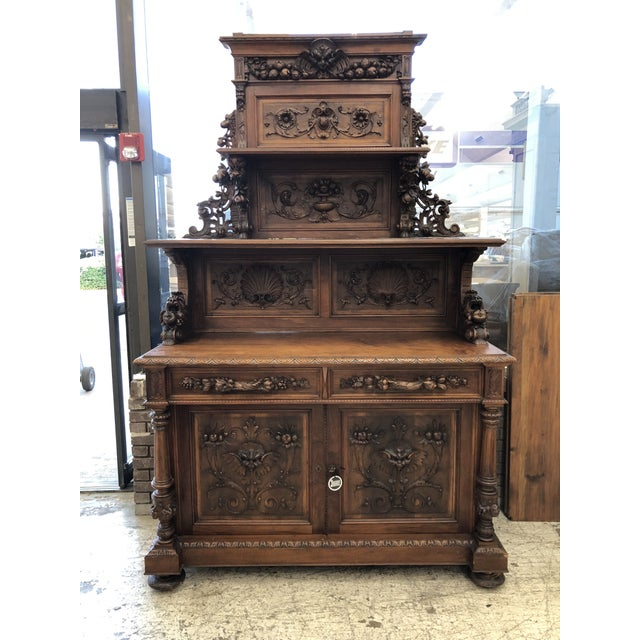 French Renaissance Revival black forest carved walnut sideboard, late 19th c., having cornice top, frieze with mask and...