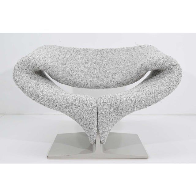 The iconic ribbon chair by Pierre Paulin designed in 1966. This chair is amazingly comfortable with high style.