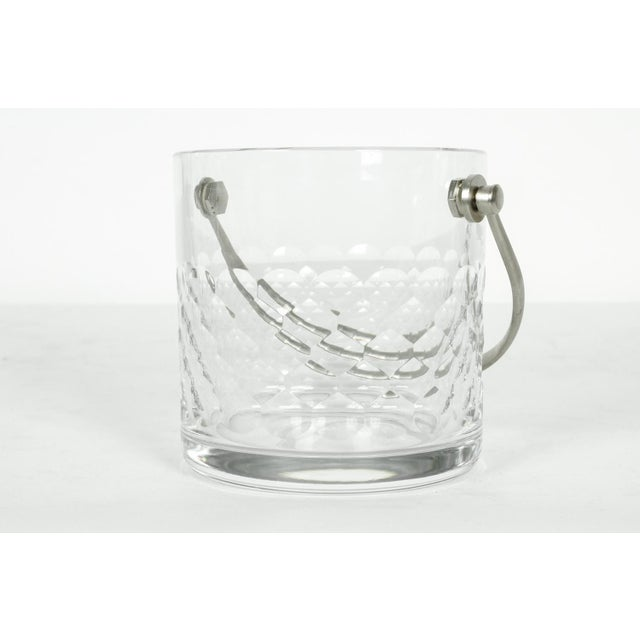 Baccarat crystal with silver plated handle ice bucket. In excellent condition. Maker's mark stamped at the bottom. The ice...