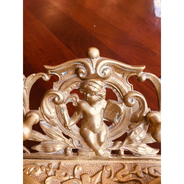 Very decorative vintage brass double inkwell with cherub and pen rest.