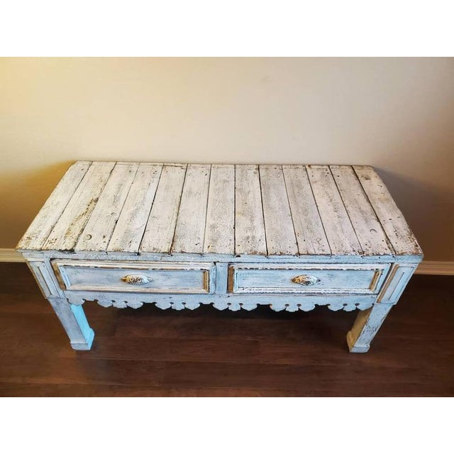 Charming and full of character, a rustic antique console / work table, in a distressed painted finish, having a plank top...