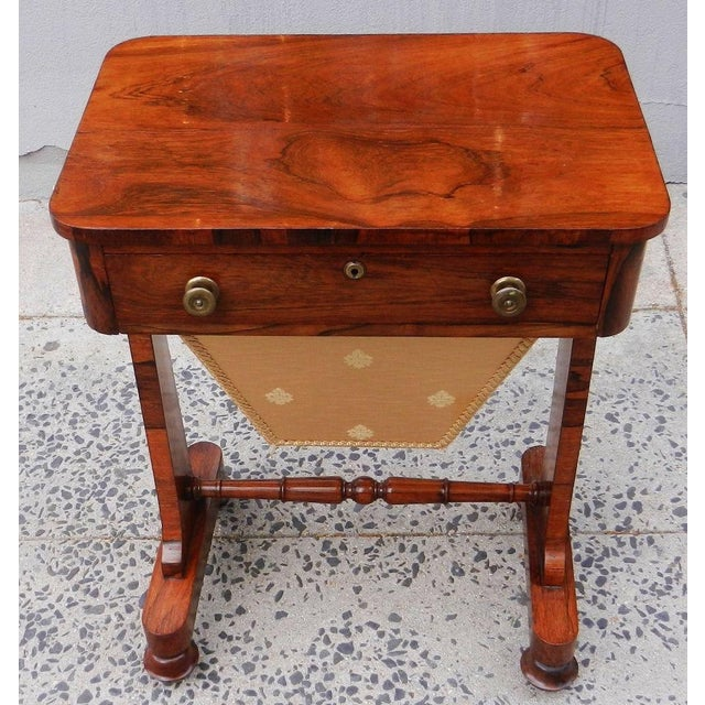Just removed from local estate is this Rare 19th century English Regency rosewood sewing table/desk. On 4 legs with castor...