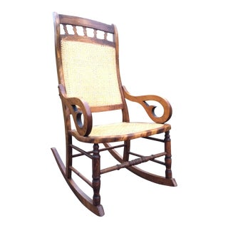 Hand Carved Oak and Cane Rocking Chair For Sale