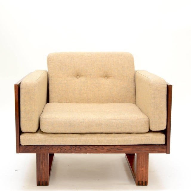 Two-seat sofa and chair set, in Brazilian rosewood by Poul Cadovius for France & Son, Denmark, 1960s. Available...